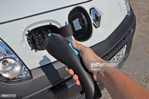 Man's hand with electric charger