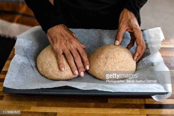 a man's hands and homemade pizza dough - gluten free bread stock pictures, royalty-free photos & images