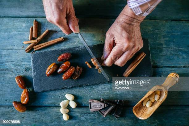 man's hands cutting dates, close-up - nut food stock photos and pictures