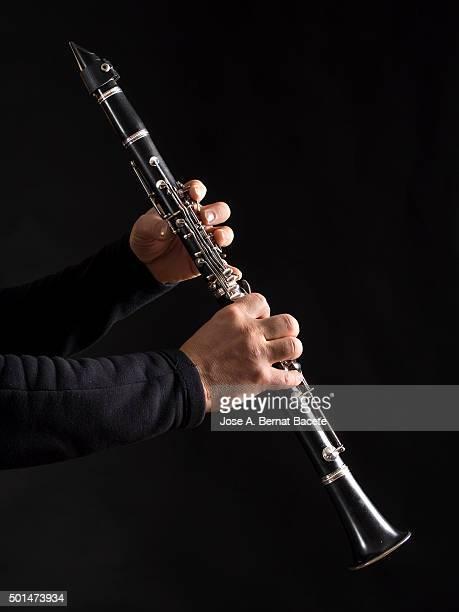 Man's Hands Drumming on clarinet
