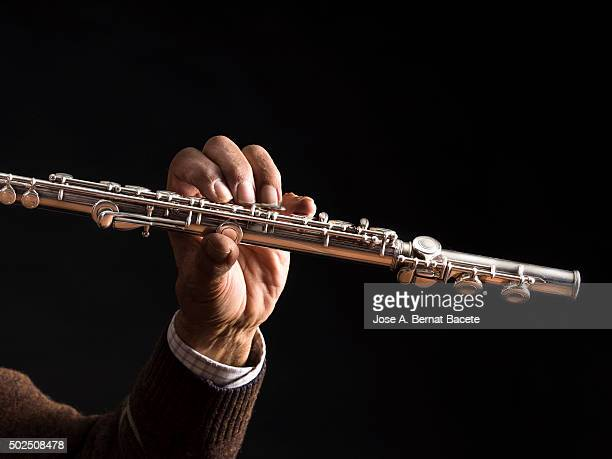 Man's Hands Drumming on flute