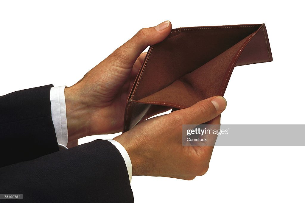 Man's hands holding empty wallet : Stock Photo