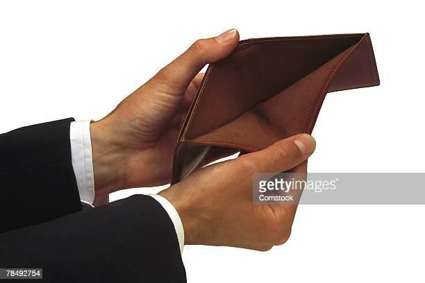 Man's hands holding empty wallet