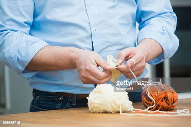 Mans hands knitting
