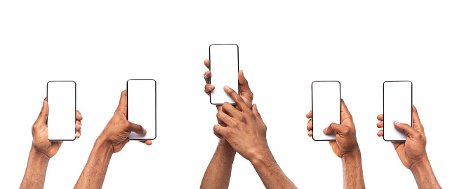 Man's hands using smartphone with blank screen on white background 1182427691