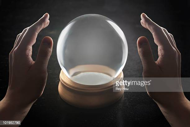 Man's hands with crystal ball