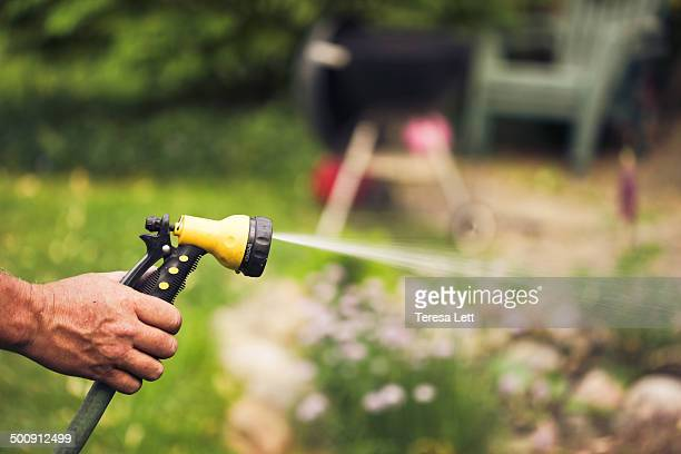 Mans hands with water sprayer