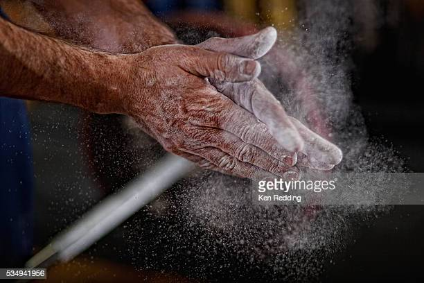man's hands with weightlifting chalk - contest stock pictures, royalty-free photos & images