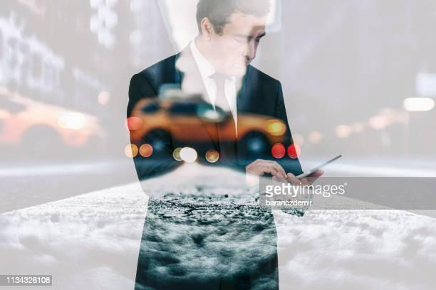 man's hands working on digital tablet, reflection of city view double exposure - bring your own device stock pictures, royalty-free photos & images