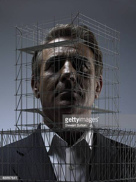 man's head surrounded by miniature scaffolding