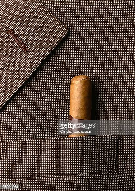 Man's jacket lapel with cigar in pocket