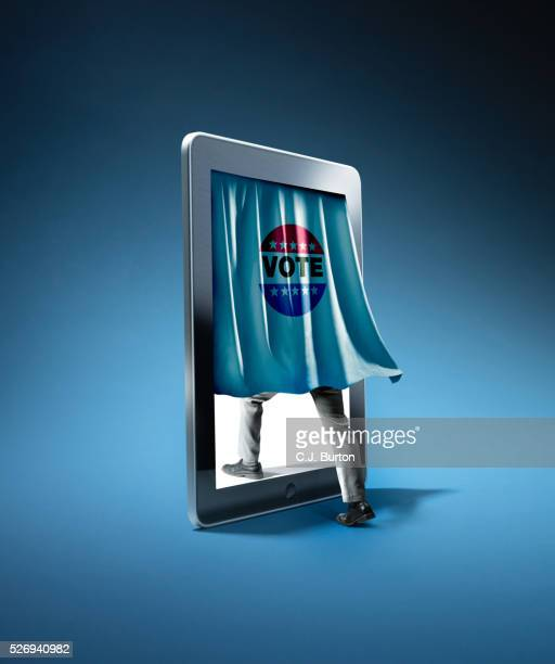a man's leg stepping into an tablet computer behind a voting curtain. - voting stock pictures, royalty-free photos & images