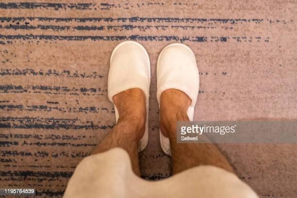 man's legs after taking a bath, with bathrobe - behaarte männer stock-fotos und bilder