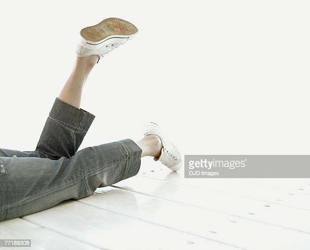 A man's legs on a deck