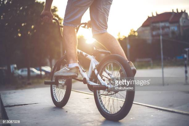 man`s legs on the bmx bicycle - bmx cycling stock pictures, royalty-free photos & images