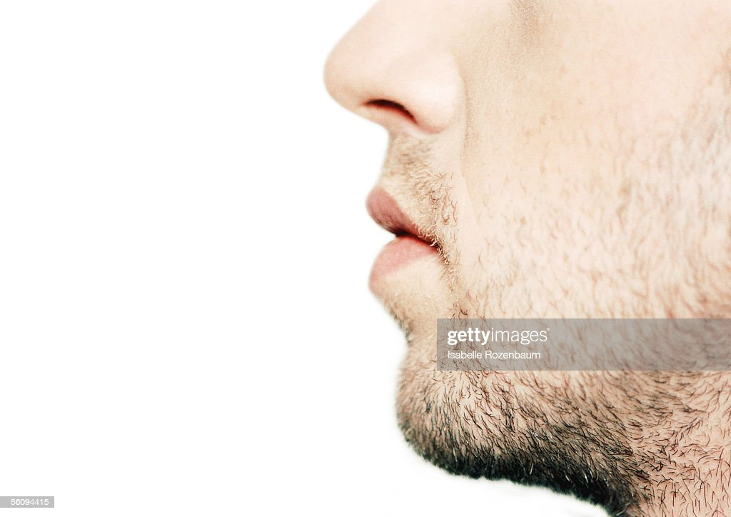 Man's lower part of face, side view, close-up : Stock Photo