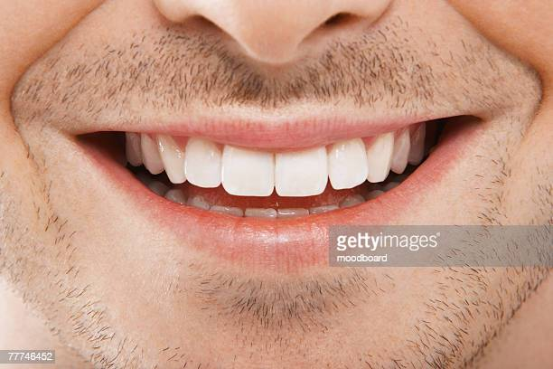 mans mouth smiling - close up stock pictures, royalty-free photos & images