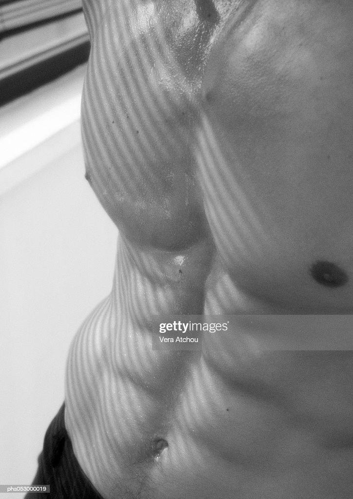 Man's naked chest, b&w : Stockfoto