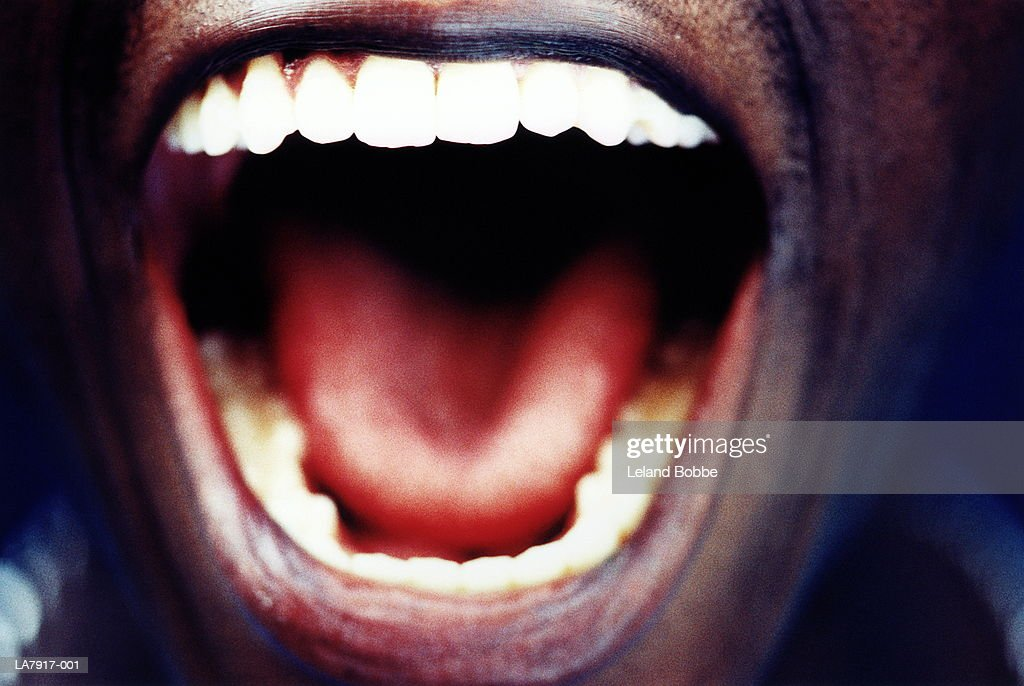Man's open mouth, close-up : Stock Photo
