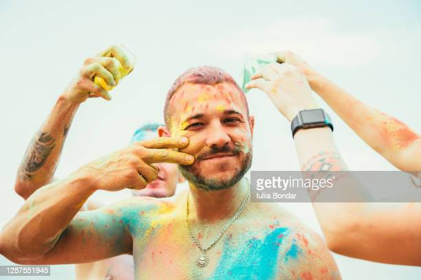 man's portrait in holi colors fastival - ceremony stock pictures, royalty-free photos & images