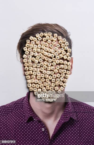 Mans portrait with face covered with cubes