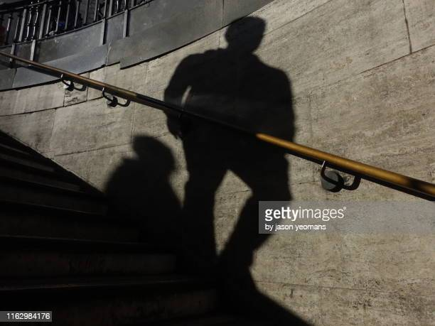 man's shadow - shadow stock pictures, royalty-free photos & images