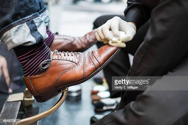 Man's shoes being shined and polished