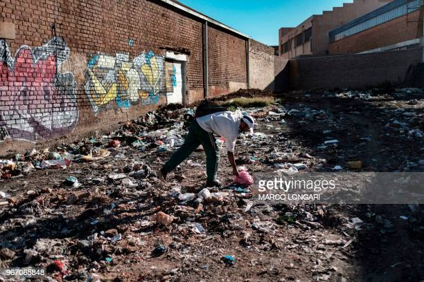 A mans sifts through garbage waste in Johannesburg on June 2 2018 On June 5 2018 the United Nations mark the World Environment Day which plastic...