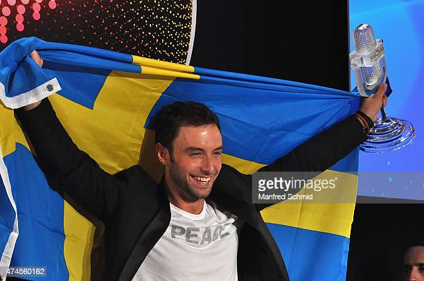 Mans Zelmerlow of Sweden holds the throphy during the press conference after winning the Eurovision Song Contest final on May 23 2015