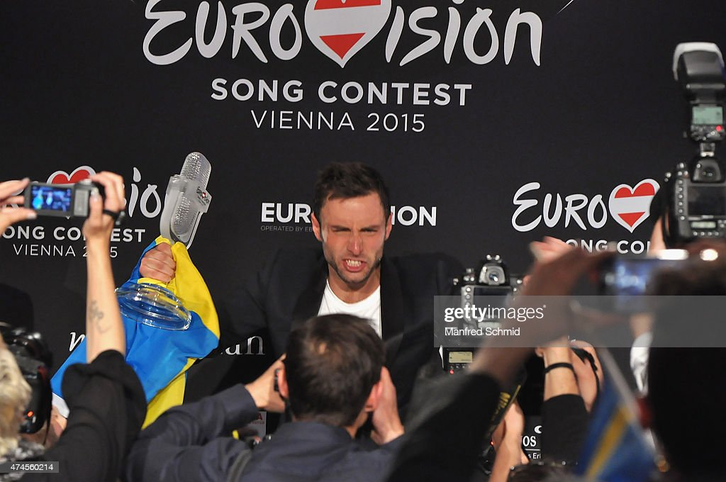 Mans Zelmerlow of Sweden holds the throphy during the press conference after winning the Eurovision Song Contest final on May 23, 2015.
