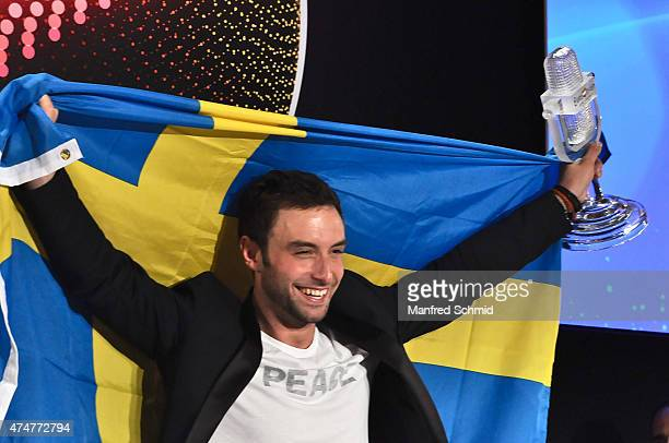 Mans Zelmerlow of Sweden holds the throphy during the press conference after winning the Eurovision Song Contest final on May 23 2015 in Vienna...