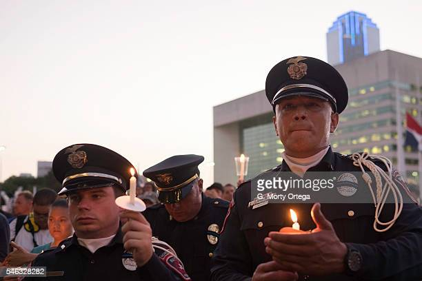 Mansfield Police Department officers Adam Sellers and James Morales attend the Dallas Strong Candlelight Vigil on July 11 2016 in Dallas Texas Five...