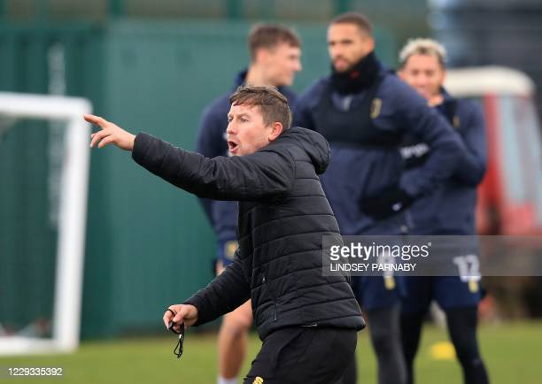 Mansfield Town FC first team coach Jamie Maguire speaks with players during their team training session at their training ground in Mansfield,...