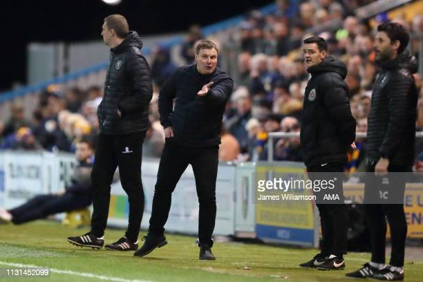 Mansfield Town manager head coach David Flitcroft gestures to Fourth Official Andrew Madley during the Sky Bet League Two match between Mansfield...