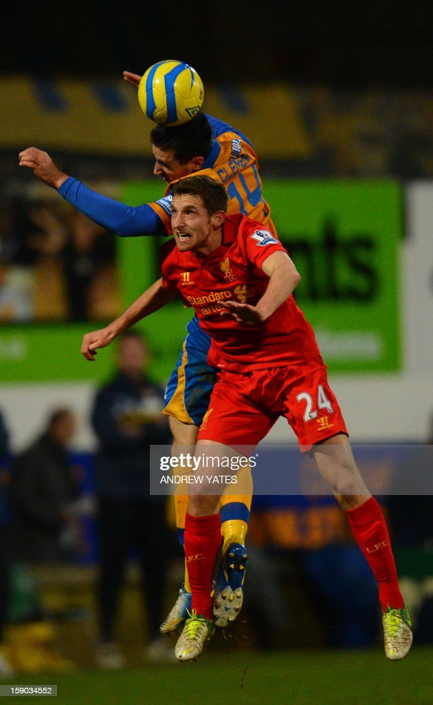 """Mansfield Town's English midfielder Chris Clements (up) vies with Liverpool's Welsh midfielder Joe Allen during the English FA Cup third round football match between Mansfield Town and Liverpool at One Call Stadium in Mansfield, Nottinghamshire, England on January 6, 2013. USE. No use with unauthorized audio, video, data, fixture lists, club/league logos or """"live"""" services. Online in-match use limited to 45 images, no video emulation. No use in betting, games or single club/league/player publications."""