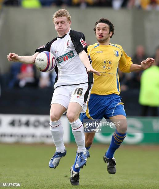 Mansfield Town's Gareth Jelleyman and Rotherham United's Jamie Yates battle for the ball during the CocaCola Football League Two match at Field Mill...