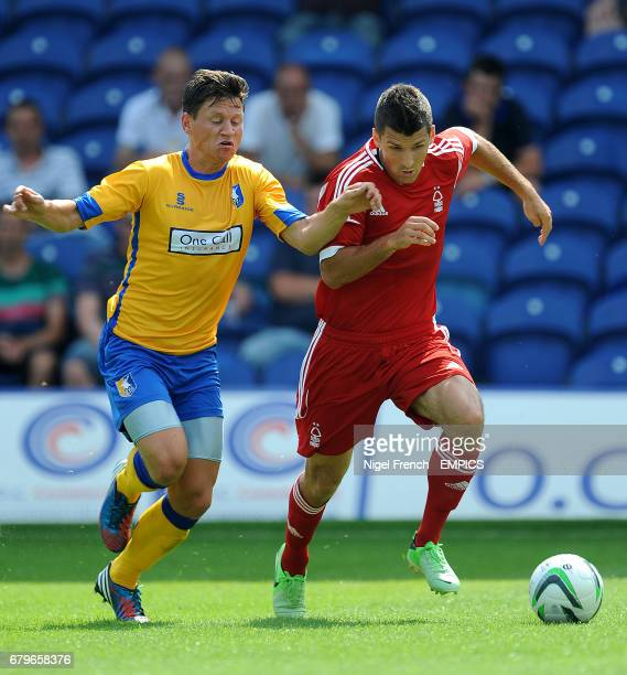 Mansfield Town's James Jennings and Nottingham Forest's Eric Lichaj battle for the ball