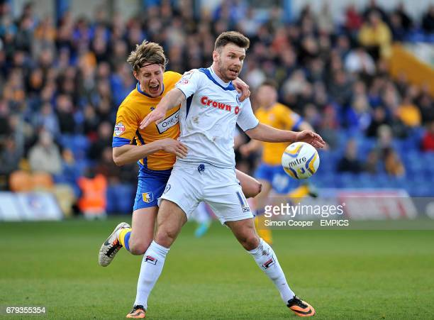 Mansfield Town's Martin Riley and Rochdale's Scott Hogan battle for the ball