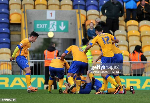 Mansfield Town's Martin Riley is mobbed by team mates after scoring his sides first goal of the game