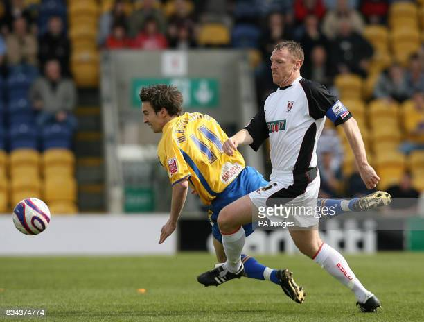 Mansfield Town's Michael Boulding and Rotherham United's Graham Coughlan battle for the ball during the CocaCola Football League Two match at Field...