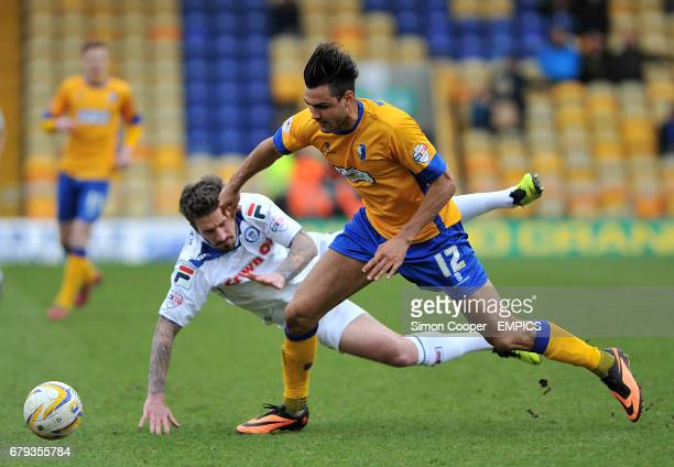 Mansfield Town's Ryan Tafazolli and Rochdale's George Donnelly battle for the ball