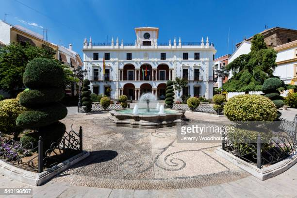 mansion and courtyard with fountain and shrubs, priego de cordoba, andalusia, spain - mansion stock pictures, royalty-free photos & images