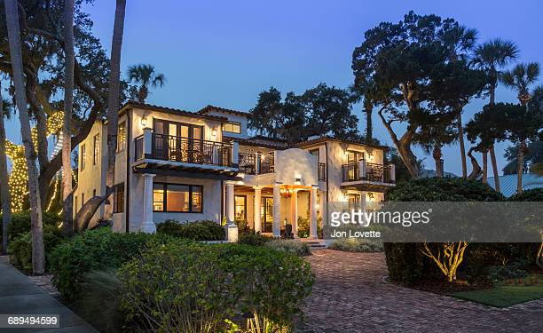 Mansion at Night Surrounded by Gardens in Florida