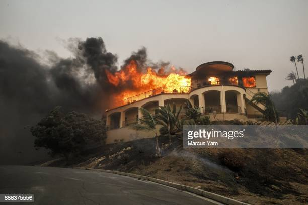 A mansion burns as a brush fire continues to threaten homes on December 5 2017 in Ventura California