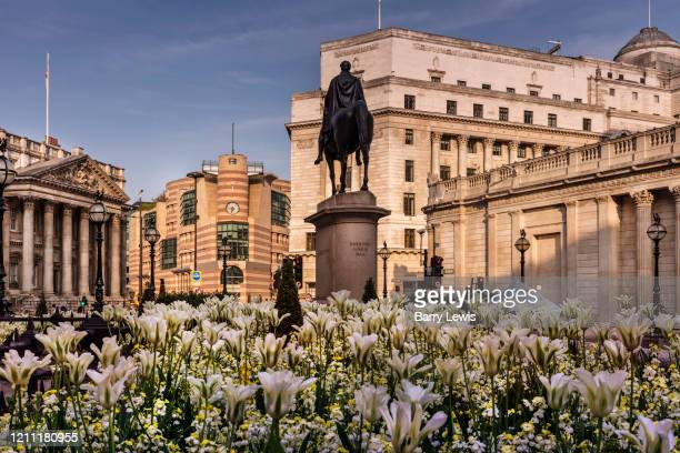 Mansion house and the equestrian statue of the Duke of Wellington viewed from the Royal Exchange garden at Bank during the coronavirus pandemic on...