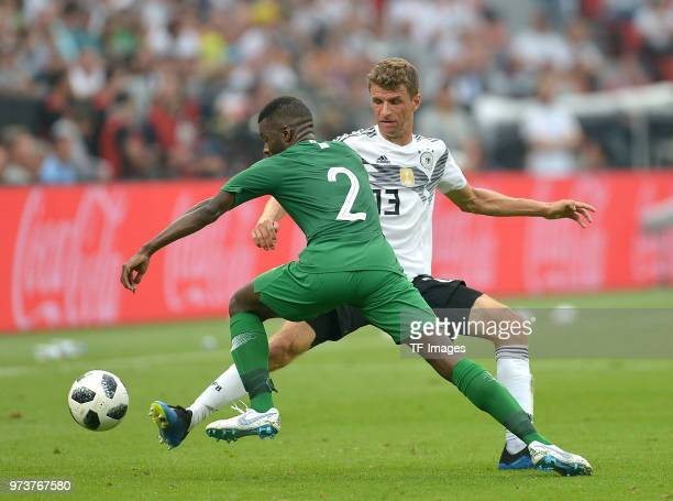Mansoor AlHarbi of Saudi Arabia and Thomas Mueller of Germany battle for the ball during the international friendly match between Germany and Saudi...