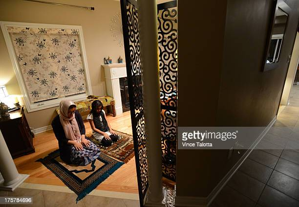TORONTO ON AUGUST 7 Mansoora Chaudhery and her daughter Areej Ahmed pray during a meal breaking their fast after fasting this month for Ramadan in...