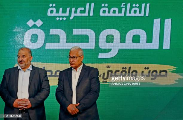 Mansour Abbas head of a conservative Islamic party Raam, accompanied by Mazen Ghanayem, his deputy, speaks to supporters from his campaign...