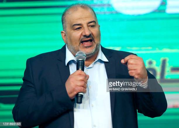 Mansour Abbas, head of a conservative Islamic party Raam, speaks at his campaign headquarters in the northern Israeli city of Tamra on March 23...