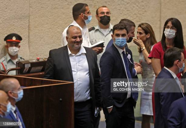 Mansour Abbas , head of Israel's conservative Islamic Raam party, attends a Knesset meeting in Jerusalem on July 7 during which Israeli...